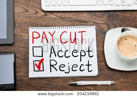 Paycut Rejection Concept In Notepad At Desk