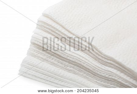 Big Stack Of White Paper Napkins Isolated On A White Background, Close Up.