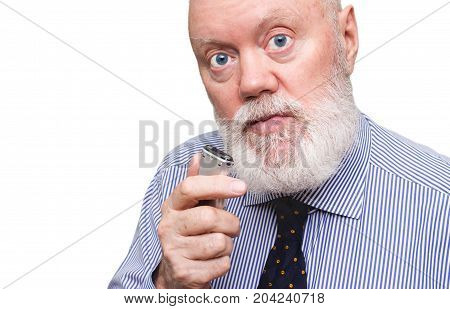 Elderly man is speaking to voice recorder on white background color and contrast manipulated
