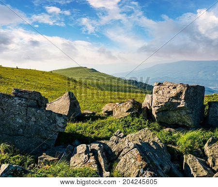 Huge Boulders On A Grassy Hillside At Sunrise