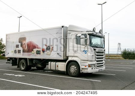 Iceland August 20 2017: Scania truck used for delivery of dairy products stands in otherwise empty parking lot.