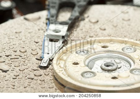 Open And Broken Hdd With Water Drops