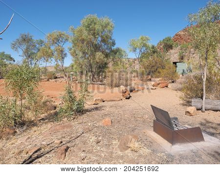 Camp ground with fire pit at remote N'Dhala Gorge near Ross River Station east MacDonnell ranges Alice Springs Northern Territory Australia 2017