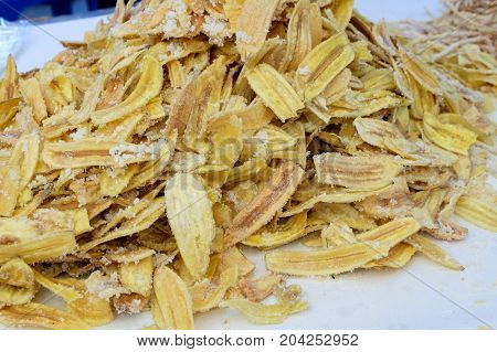 sweet banana crisps with sugar and salt is sold at the market