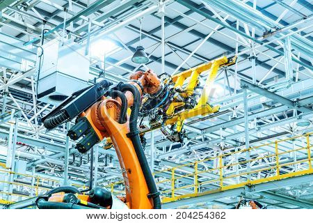 Modern car production line is working in the robot