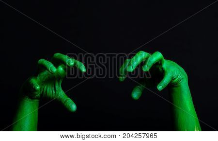 zombie Halloween hand with a claw taken in a studio for cutout