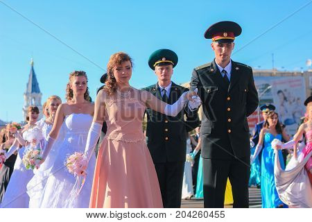Zhytomyr, Ukraine - MAY 19, 2014: Military and civil people dancing at the ball at midday
