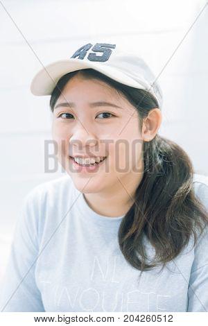 portrait of cute innocent asian teen women smile with good healthy dental white beautiful teeth