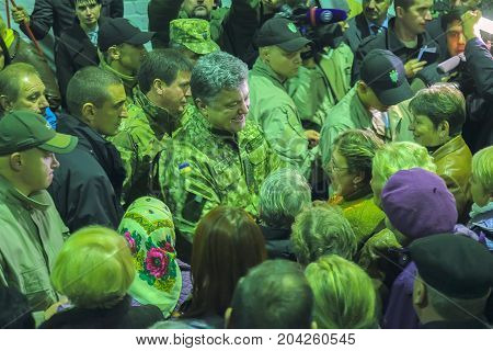 ZHYTOMYR, UKRAINE - Oct 10, 2014: President Petro Poroshenko took part in opening tank factory with people