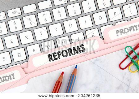 Reforms concept. Folder Register on Background of Computer Keyboard.