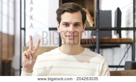 Young Man Showing Victory Sign , Success In Investment