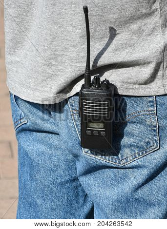 Walkie-talkie in the pocket of a man
