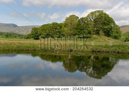 Langdale Pikes reflected in River Brathay, English Lake District
