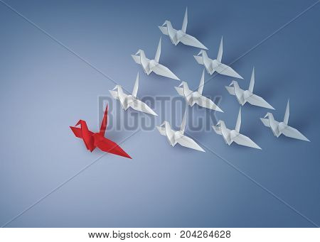 leadership concept with origami red and white bird on blue background .paper art and craft style.