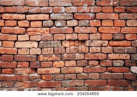 Brick wall. A fragment of an old brick wall