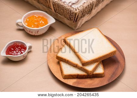 Toast With Strawberry And Orange Jam On A Plate On Table.