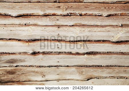 Plank surface built of parallel rustic wood slats to use as a background