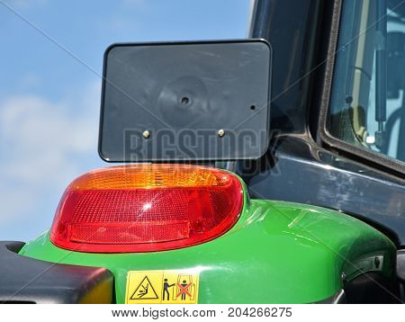 Tail light and license plate holder of a tractor