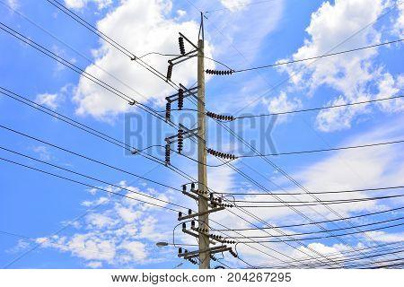 High Voltage Poles on cloud blue sky background