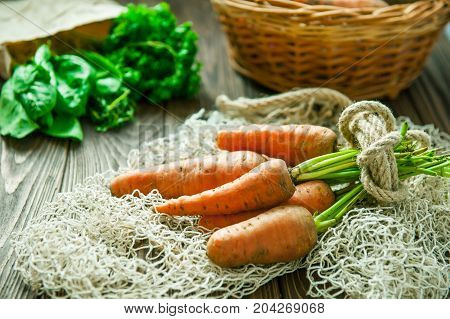 Bunch Of Fresh Organic Dirty Carrots And Oher Purchased Products From Farm Market On The Wooden Back
