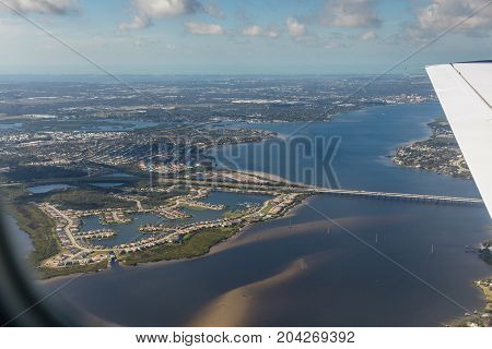 Aerial view of city Bradenton Florida. Approach to land at the airport in St. Petersburg. Manatee River Florida