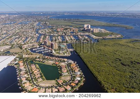 Aerial view of city and gulf Cape Coral Florida. The Westin Cape Coral Resort at Marina Village