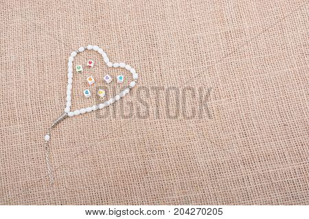 Heart shaped cubes in hand by inside a praying beads