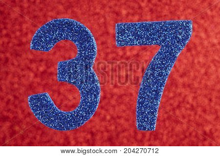 Number thirty-seven blue color over a red background. Anniversary. Horizontal