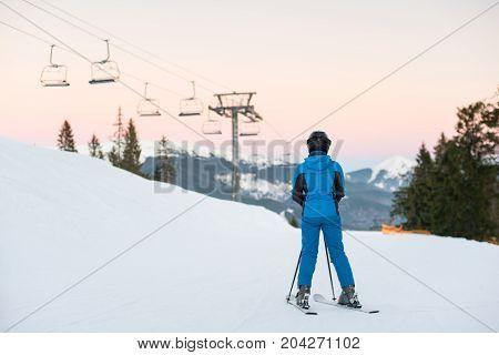 Woman Skiers Standing On Snowy Mountain Enjoying Beautiful Mountain Landscape On A Winter Resort At
