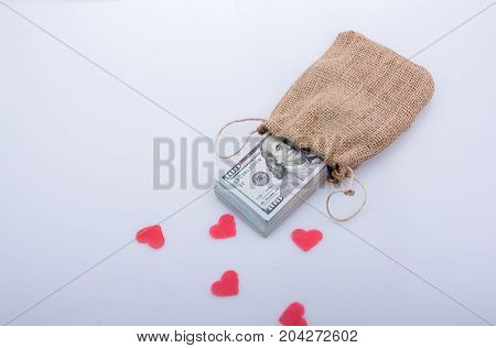 Red Hearts And Bundle Of Us Dollarin A Sack