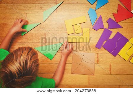 little boy playing with puzzle, education and learning concept