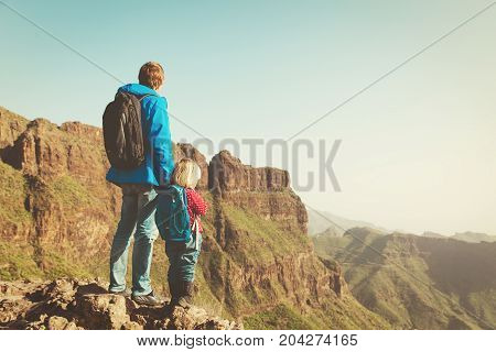 father and little daughter hiking in mountains, family travel