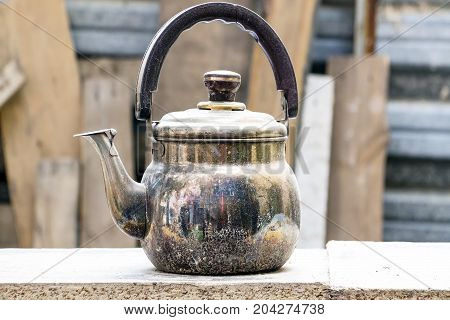 The old copper kettle on a natural background