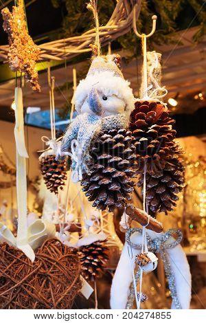 Closeup snowman at traditional christmas market holiday postcard