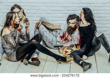 Halloween Friends Relaxing On Wooden Floor