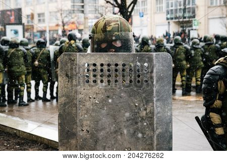 Minsk Belarus. Special police unit with shields against protesters. Belarusian people participate in the protest against the decree 3 Lukashenko and the current authorities.