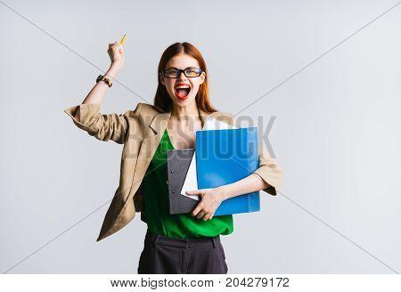 Joyful student  professor  teacher raises her hands up, won, success and luck