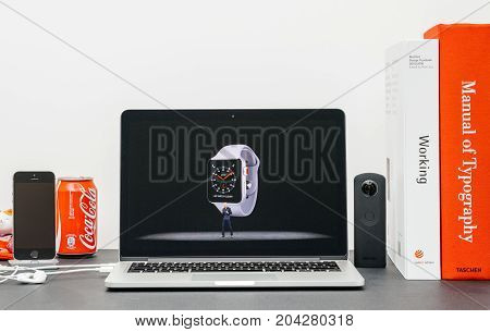 PARIS FRANCE - SEP 13 2017: Minimalist creative room Safari Browser open on MacBook Pro laptop showcasing Apple Keynote website - Apple COO Jeff Williams presenting the Apple Watch 3 advantages