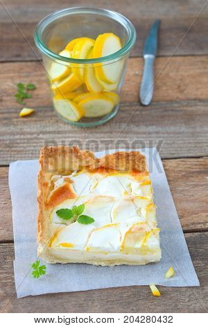 Zucchini tart with thin slices of zucchini beautifully layered on top.