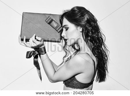 Sexy Woman With Red Lips, Long Hair Holds Present Box