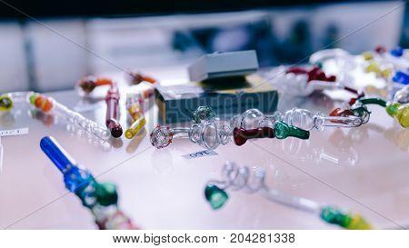 Glass Bongs For Smoking Weed Close-up Soft Focus. Smoking Accessories Marijuana