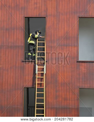 firefighter exercise while climbing in the fire station building