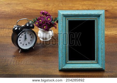 Blue wooden photo frame with item on wood, Travel and vacation background with clipping path.