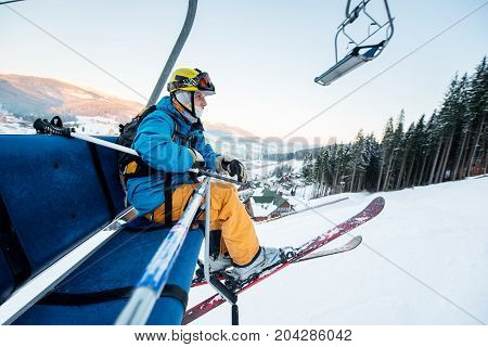 Shot Of A Skier Sitting On A Ski Lift Chair Riding Up To The Top Of The Mountain Copyspace Winter Ex