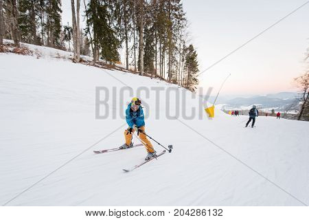 Guy On Skis Riding Down The Mountain Slope And Taking Selfie With Stick On The Winter Resort