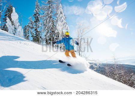 Shot Of A Male Freerider Skiing In The Mountains On Fresh Powder Snow On A Beautiful Sunny Winter Da