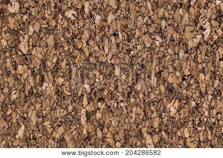 A dark brown cork texture background - Close up