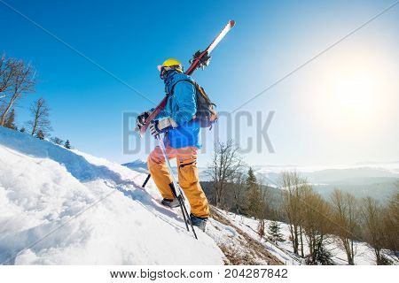 Shot Of A Male Skier Walking Up The Slope In The Mountains Carrying His Skis Copyspace Active Lifest