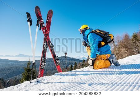 Rearview Shot Of A Skier Enjoying On Top Of The Mountain Beautiful Snowy Mountains View Near His Ski