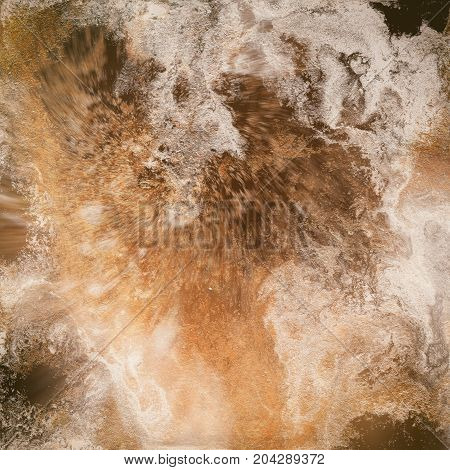 Abstract liquid gold background. Pattern with abstract golden and black waves. Marble. Handmade surface. Liquid paint. Acrillic wallpaper. Mineral textured hand draw painting